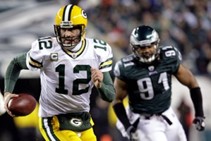 With patience and poise, Rodgers leads Packs to next round