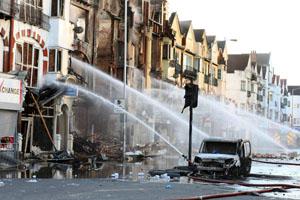 British officials condemn riots as violence continues