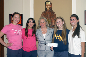 TLC presents gift to St. Peter Claver School