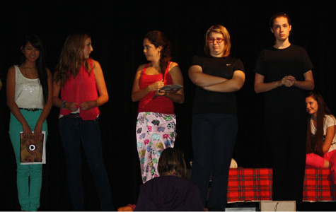The Cast surrounds Ms. Cox and Ms. Linda for quick notes about their run through.