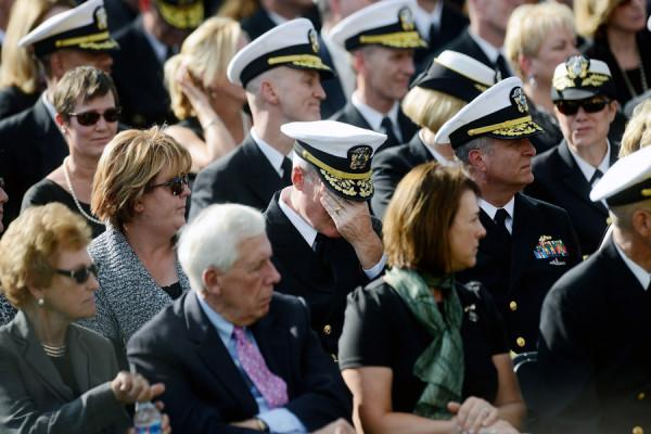 Navy Officers attending the memorial mourn for the soldiers who lost their lives at the Navy Yard in Washington D.C.