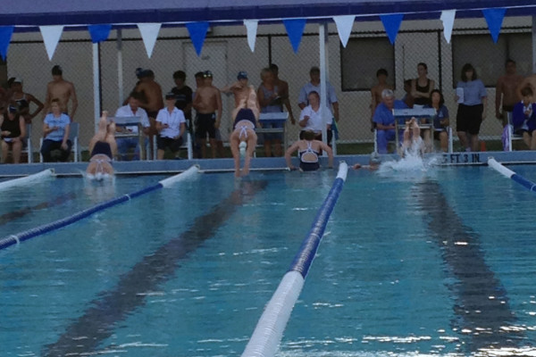 Senior Clare Flemming dives into the water.