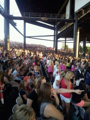 Thousands of fangirls await the start of a One Direction concert in Chicago over the summer.
