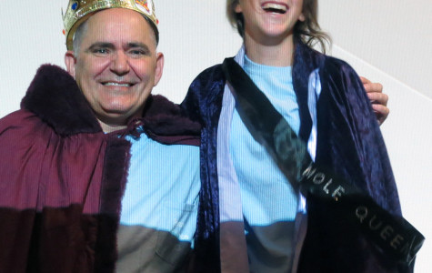Theology teacher Felix Kalinowski and Sophomore Jeanine Ramirez are crowned as the 2013 Mole King and Queen.