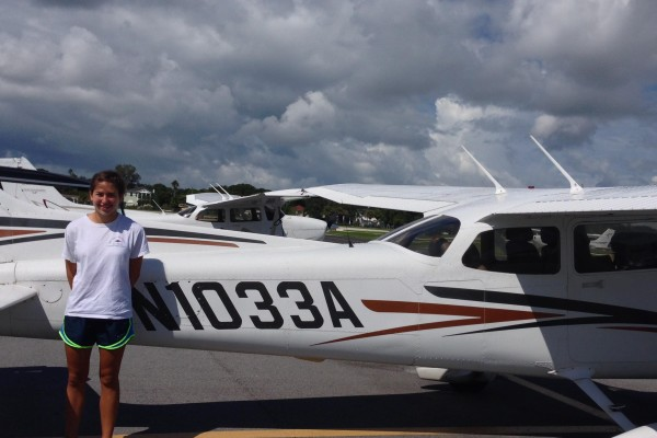 Mariah Diaz smiles after completing her first solo flight