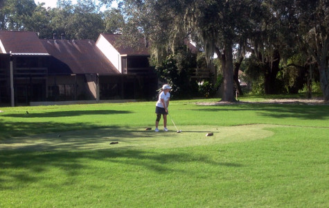 Sophomore Jeanine Ramirez teeing off at Emerald Greens on October 1, 2013.