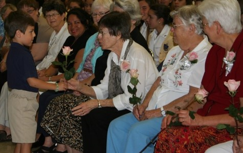 Sister Lillian Schneider and fellow SNJM sisters, each received a rose in appreciation