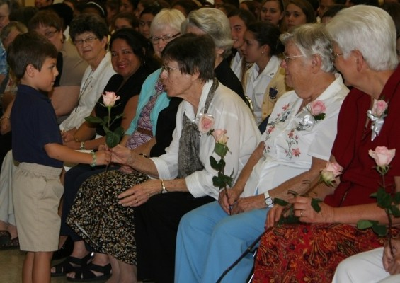 Sister+Lillian+Schneider+and+fellow+SNJM+sisters%2C+each+received+a+rose+in+appreciation+