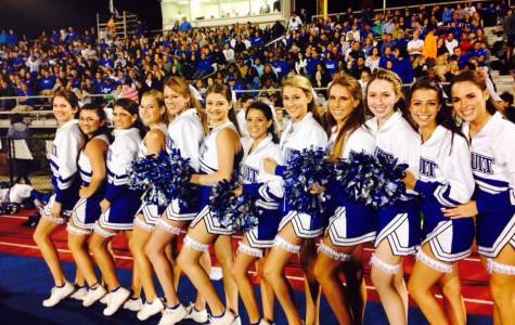 The senior Jesuit cheerleaders pose together on their senior night.