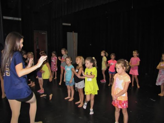 Gaby Ruiz reviews the dance moves with her campers