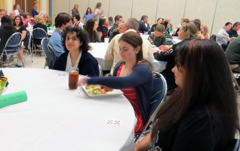 Colleen McInerney receives the only First World meal at her table.