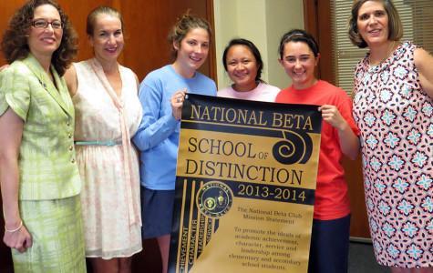 Principal Camille Jowanna presented the honor to Beta members Alison Foley, Carmelle Kuizon, and Caroline Kimbler.