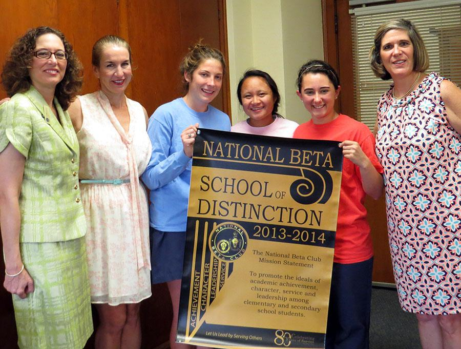 Principal Camille Jowanna presented the honor to Beta members Alison Foley, Carmelle Kuizon, and Caroline Kimbler.