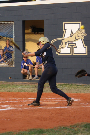 Batter takes a swing on the ball