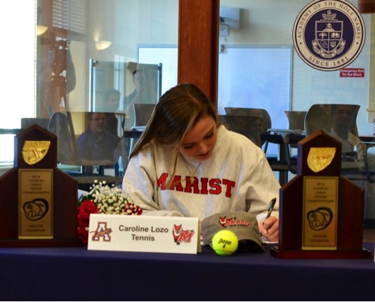 Caroline signs to finalize her commitment to Marist College