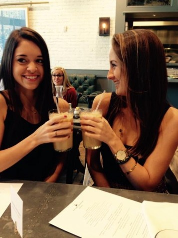 Gaby Ruiz and Jourdan Collins enjoying iced lattes at Oxford Exchange