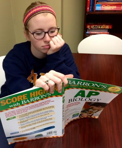 Senior Olivia Brink reviewing for her AP Biology exam