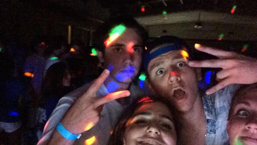 Seniors Remi Storch and Avery Dierks enjoy the music and colorful lights with some of their Jesuit brothers!