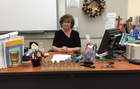 Beth Chase working hard at her desk and encouraging her students.