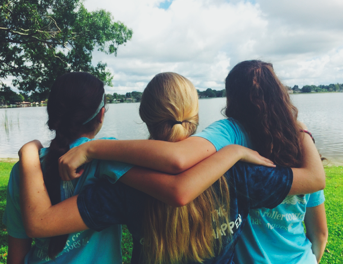 Sophomores Gretchen Swenson, Evelyn Martinez, and Julia Lavoy admire the lake. Credit: Audrey Diaz