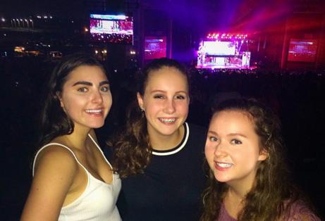 It is concert season! Sophomores Kayla Eckermann, Gretchen Swenson, and Audrey Diaz enjoy a concert featuring their favorite bands.