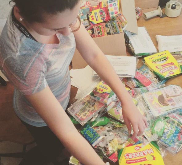 Shannon prepares a package to ship off to a child with cancer.
