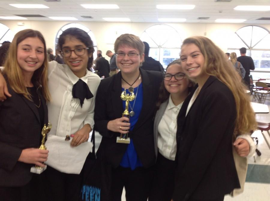 AHN Speech and Debate team celebrate members placing at recent competition.  Credit: Jaimie Meyer(used with permission)
