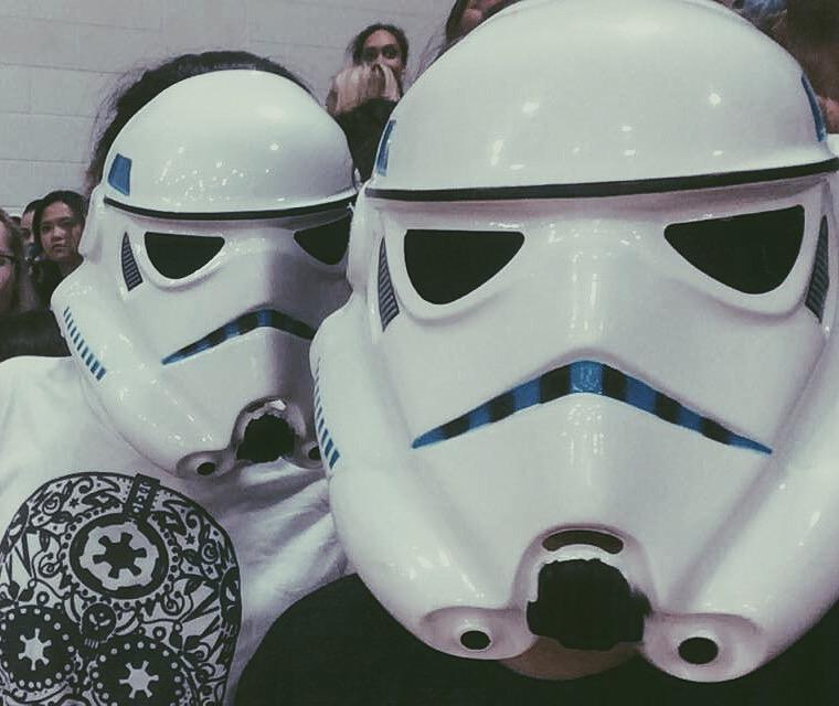 Seniors Gabi Vivero and Isabella Alfonso show off their dark side with their realistic storm trooper masks at the AHN vs TC basketball game.