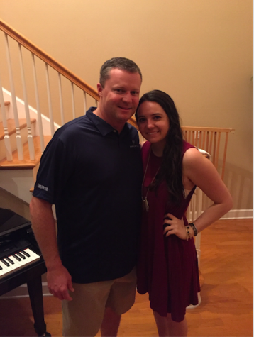 Senior Caroline Swenson and her father, Mike Swenson, pose for a photo together