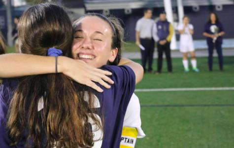 Lester tearfully embraces junior defender Ellie Abdoney on senior night, the last home game of the regular season.