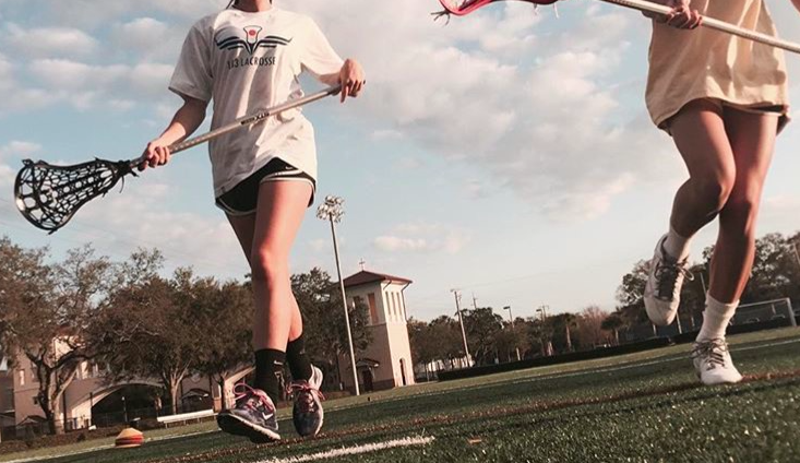 Sophomores Mia Lopez and Alexa Traviesa practice ground balls while preparing for the upcoming lacrosse season. Credit: Alexa Traviesa (used with permission)