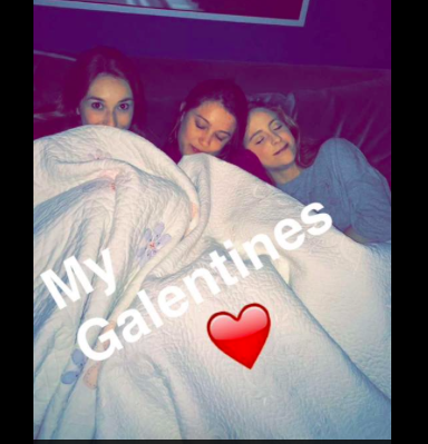 Megan and friends celebrating Galentine's day together with chocolate and a movie