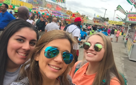 Alejandra Lozano, Alma Torres and Karlee Nipper pose with all the vendors at the State Fair after getting some fried oreos!