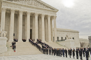 Former law clerks of Justice Antonin Scalia line up as he is brought into the Supreme Court.