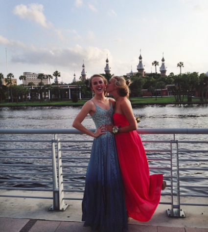 Grace Toups and Audrey Cooper posing as each others dates after making the decision to go stag to prom