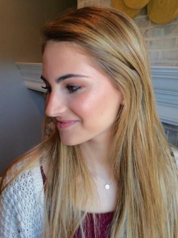 Senior, Carolina Oliva, shows off her highlighted cheek bone with an illuminated makeup look