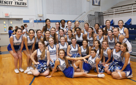 The Jesuit Cheer Team supporting the Tiger's at one of their basketball games.