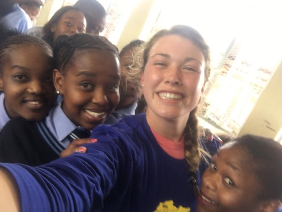 Credit: Abby Morris (Used with Permission) Morris smiles with some of the students at the Manaleni Achievement Center.