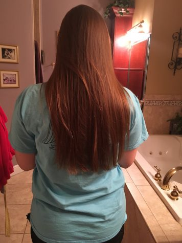 Senior Emilie Ulbricht has long healthy hair even though she gets it cut on a regular basis.