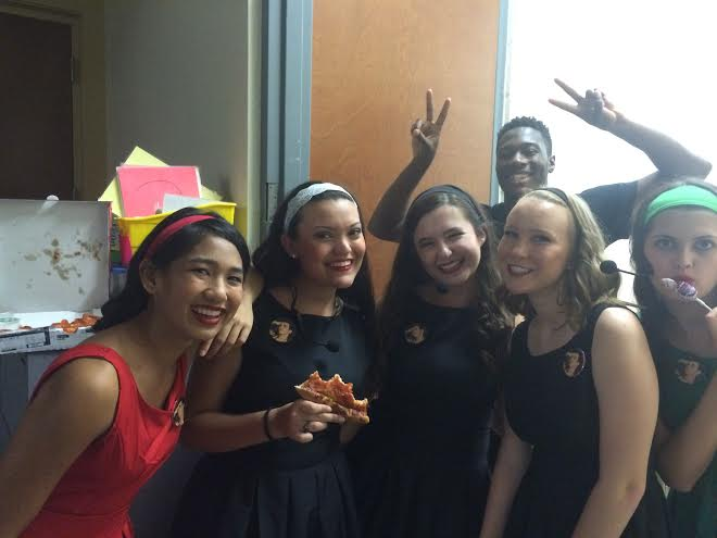 Here some of the girls from the chorus are enjoying pizza backstage during intermission.