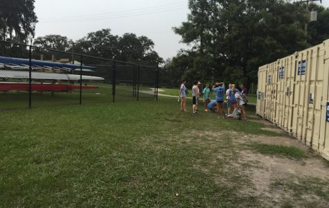 Another day, another practice.... and another boathouse? Academy crew gathers near the boathouse they built. Photo Credit: Audrey Anello/Achona Online