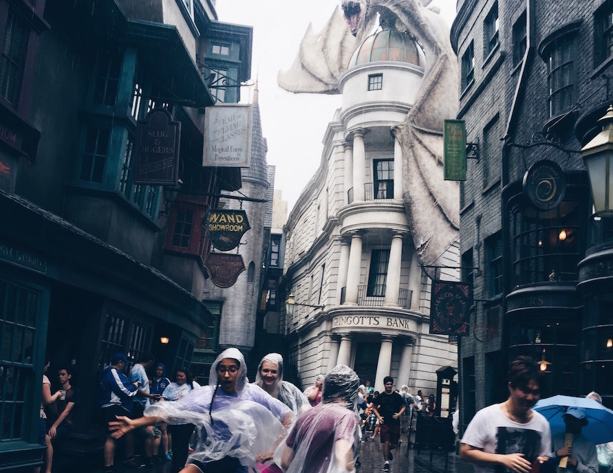 Tourists may be scared of the rain but that does not stop Academy girls from dancing in Diagon Alley. Credit: Grace Neal/AchonaOnline