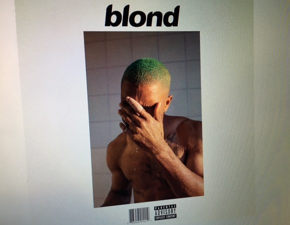 The new album has a simple layout and features a photo of Ocean sporting his new green locks.