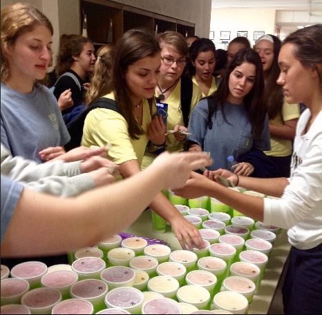 Senior Ciara Chappell sells smoothies to the frenzied crowd.
