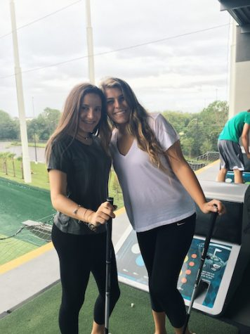 Sophomores Brianna Benito (left) and Gelmi Pasquier (right) enjoying their time at Topgolf.