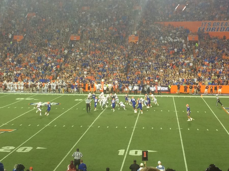 Although it was pouring rain for the first half of the game, thousands of Gator fans packed the stadium to cheer their team on to victory.