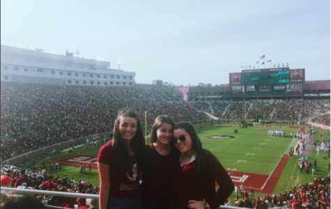 Junior Lauren Perez and her family pose in front of the FSU game