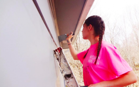 Credit: Maria Cacciatore/ Achona Online  Senior, Maria Cacciatore loves painting houses on her mission trip last year in Appalachia.
