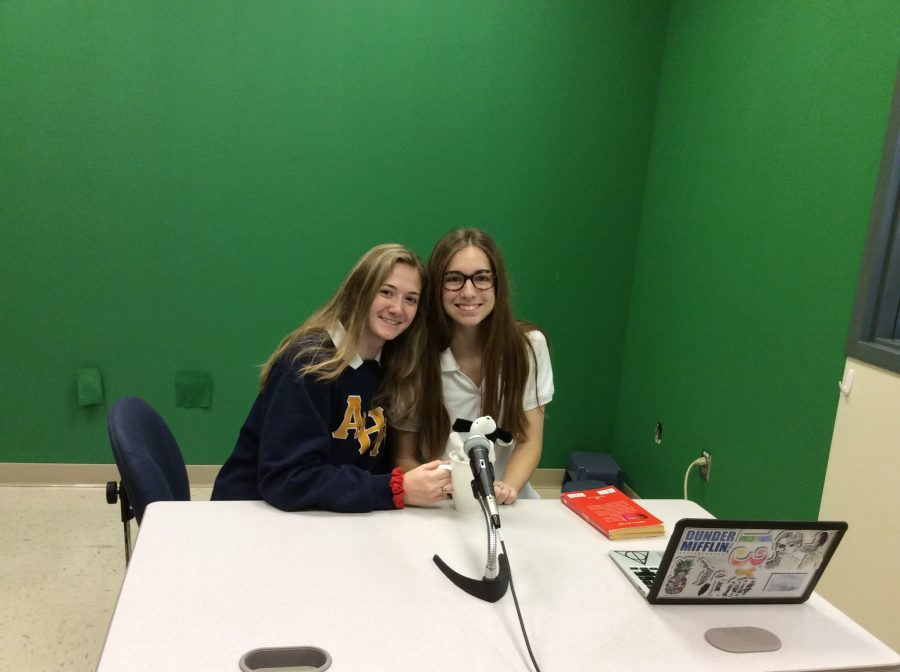 Senior President Ally Wehle and senior Vice-President Danielle Gutierrez offer up the daily news with a coffee mug and a stuffed animal dog to show that they are real news reporters.