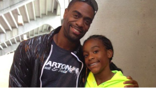 Trinity's father came to support her at one of her first track meets.